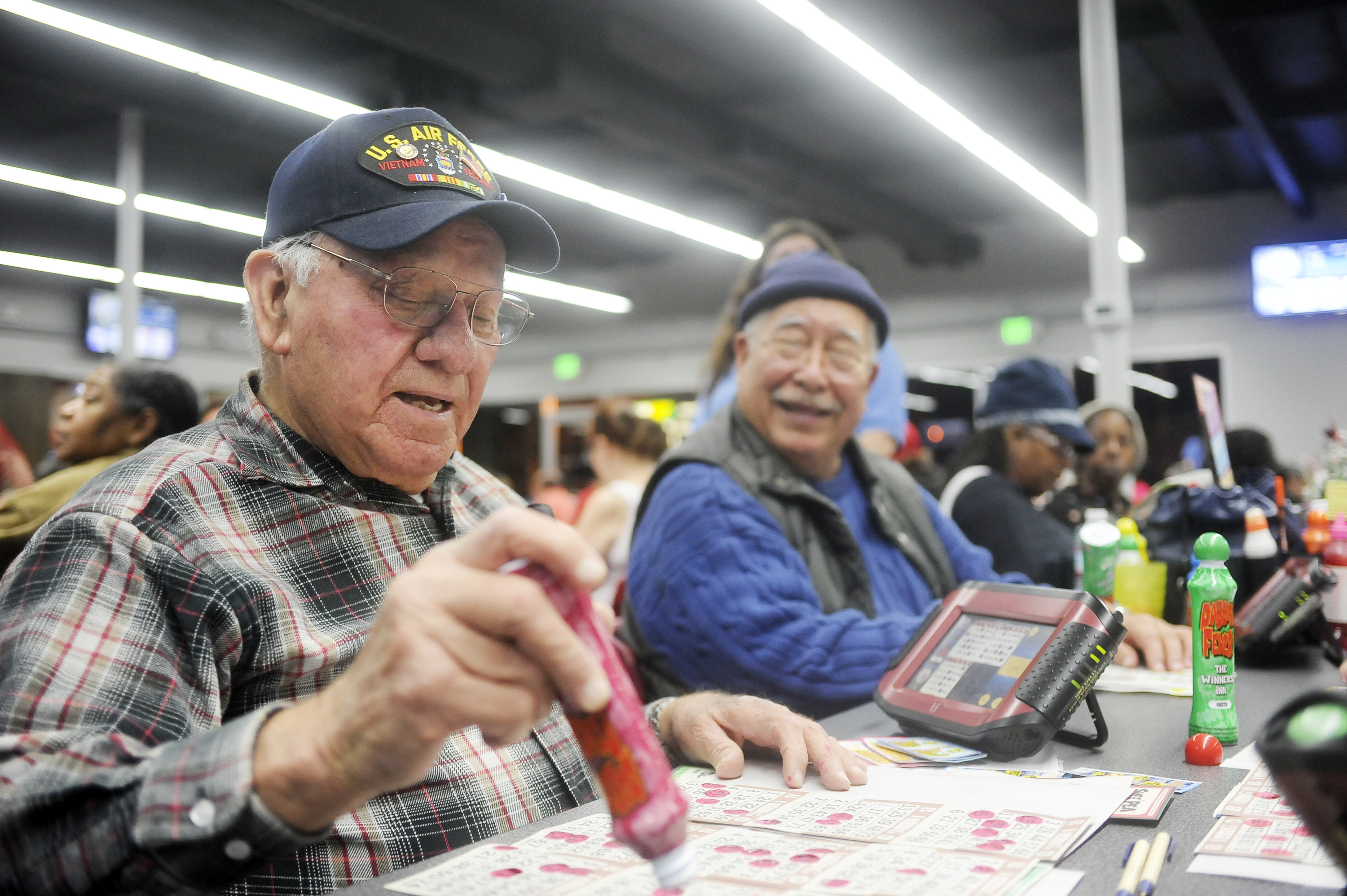 Harry Bordallo marks his cards while playing bingo Friday, at the Blue Devils Bingo Hall in Suisun City. (Adam Smith/Daily Republic)